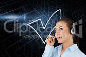 Composite image of tick symbol and call centre worker