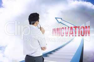 Innovation against red staircase arrow pointing up against sky