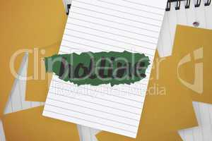 Hotline against yellow paper strewn over notepad