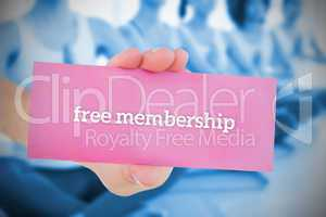 Woman holding pink card saying free membership