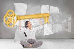 Composite image of businesswoman sitting cross legged carrying l