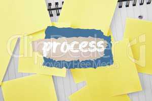 Process against sticky notes strewn over notepad