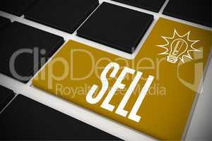 Sell on black keyboard with yellow key
