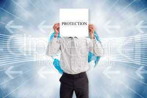 Businessman holding card saying protection