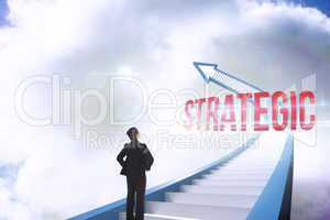 Strategic against red staircase arrow pointing up against sky