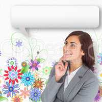 Composite image of smiling thoughtful businesswoman with speech