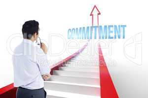 Commitment against red arrow with steps graphic
