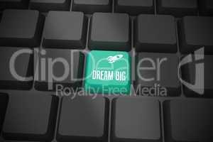 Dream big on black keyboard with green key