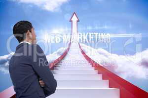 Web marketing against red steps arrow pointing up against sky
