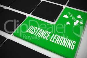 Distance learning on black keyboard with green key