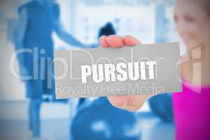 Fit blonde holding card saying pursuit