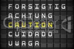 Caution in languages on black mechanical board