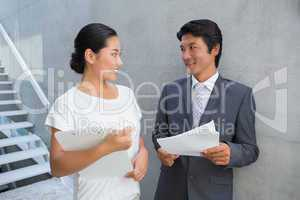 Estate agent showing lease to customer and smiling