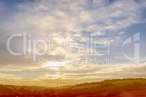 Scenic landscape with blue cloudy sky