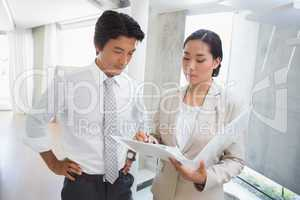 Estate agent showing lease to customer