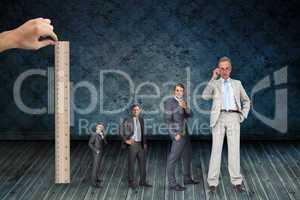 Composite image of hand measuring stages of businessmans life with ruler
