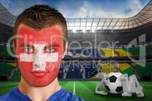 Serious young switzerland fan with facepaint