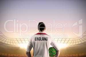 England football player holding ball