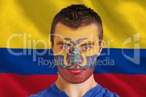 Serious young ecuador fan with facepaint