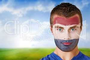 Netherlands football fan in face paint