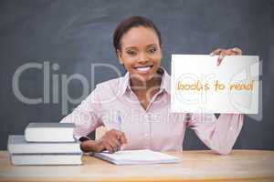 Happy teacher holding page showing books to read