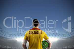 Australia football player holding ball