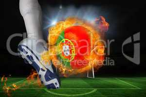 Football player kicking flaming portugal flag ball
