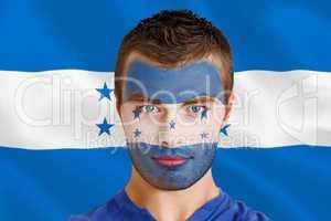 Serious young honduras fan with facepaint