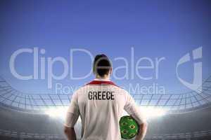 Greece football player holding ball