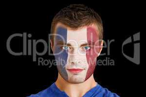 Serious young france fan with facepaint