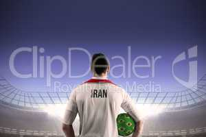 Iran football player holding ball