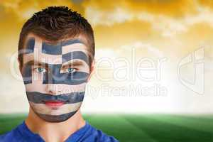 Greek football fan in face paint