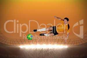 Football player in orange jumping