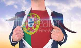 Businessman opening shirt to reveal portugal flag
