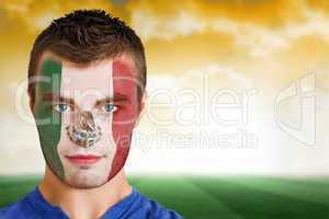 Mexico football fan in face paint