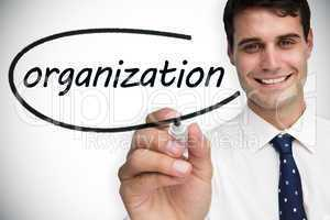 Businessman writing the word organization