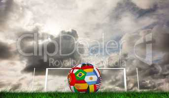 Composite image of football in multi national colours