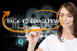 Businesswoman writing the words back to education