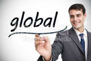 Businessman writing the word global