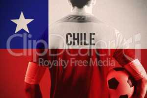 Composite image of chile football player holding ball