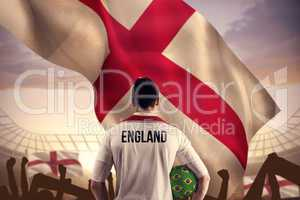 Composite image of england football player holding ball