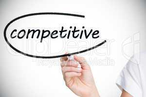 Businesswoman writing the word competitive