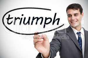 Businessman writing the word triumph