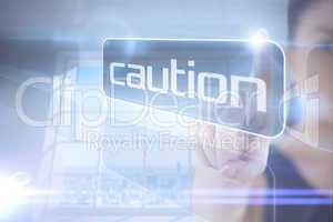 Businesswoman pointing to word caution