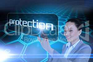Businesswoman pointing to word protection