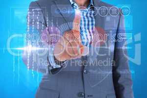 Businessman touching the words social networks on interface