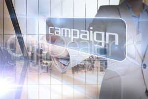 Businesswoman presenting the word campaign
