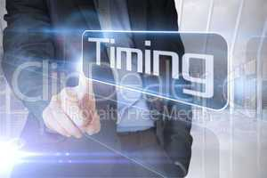 Businessman presenting the word timing