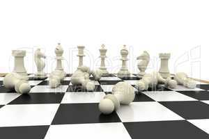 Fallen white pawns on chess board