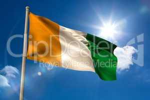 Ivory coast national flag on flagpole
